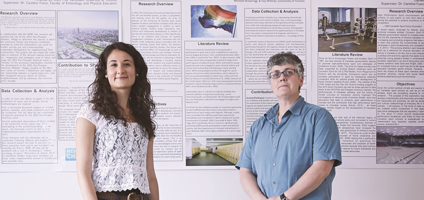 Professor and student in front of research poster