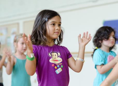 Kids learning basic dance skills