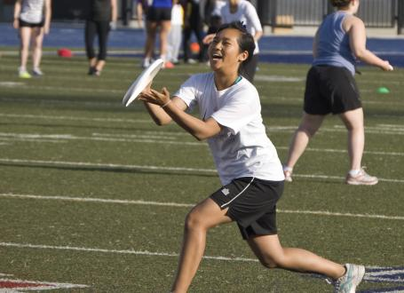 Girl catching frisbee