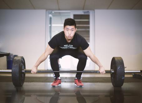 A man preparing to lift weights