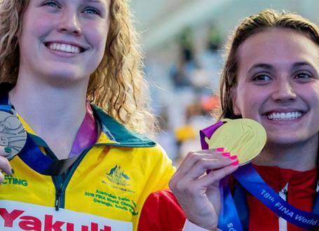 Kylie Masse holding medal at FINA World Championships